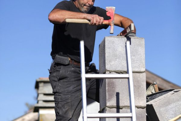 builder-constructing-a-chimney.jpg